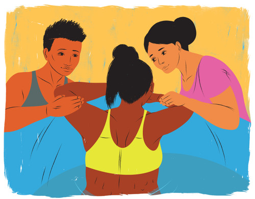 Two doulas helping mother during water birth