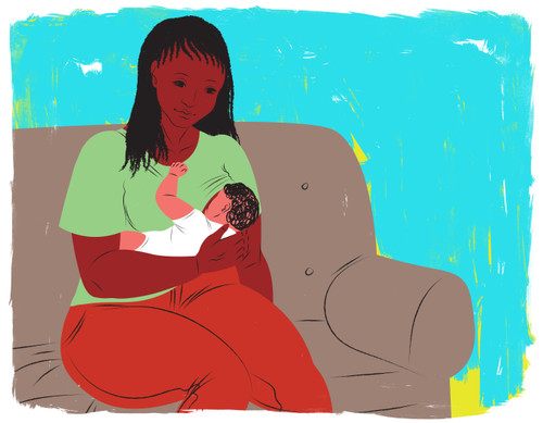 Mother breastfeeding on couch