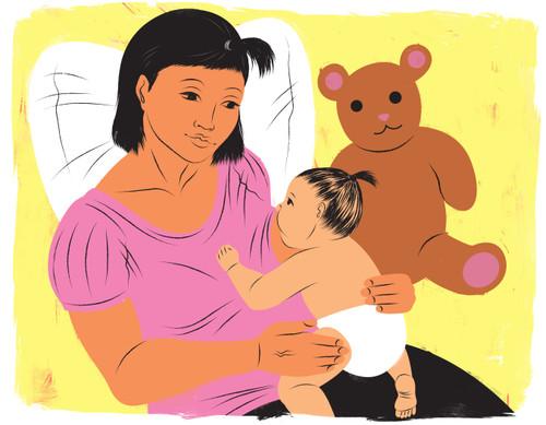 Young breastfeeding mother breastfeeding next to teddy bear