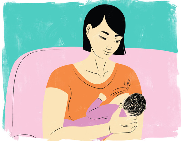 Mother breastfeeding on pink couch