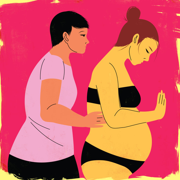 Doula and mother during labor