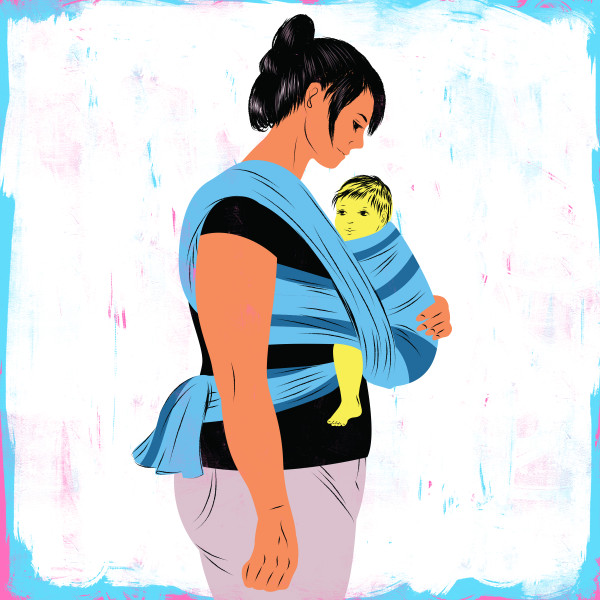 Baby wearing mother