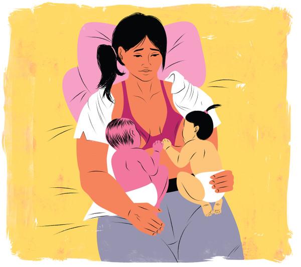 Mother breastfeeding her twin babies