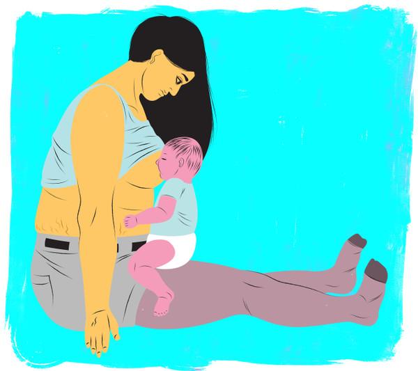 Mother breastfeeding using the koala position