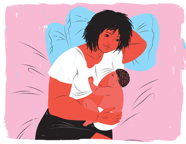 Mother breastfeeding in side lying position on bed