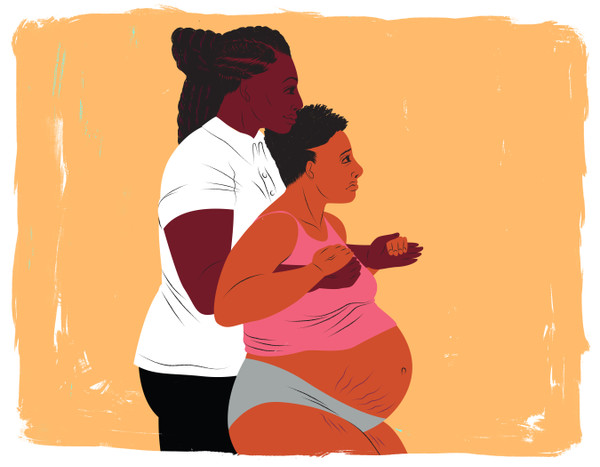 Doula supporting a standing mother during labor