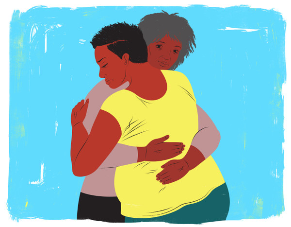 Doula holding mother in embrace during labor