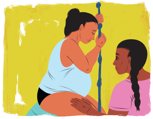 Doula helping mother in labor with birthing rope
