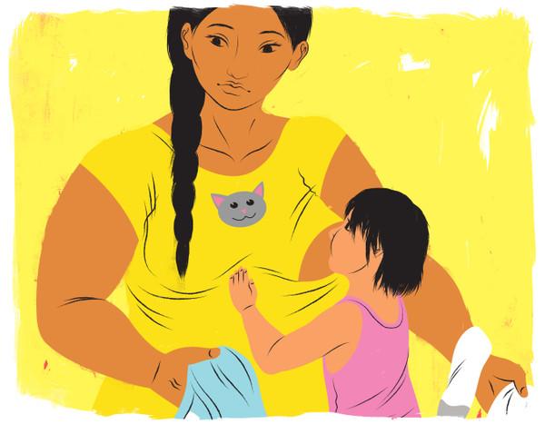 Mother breastfeeding older child while doing laundry