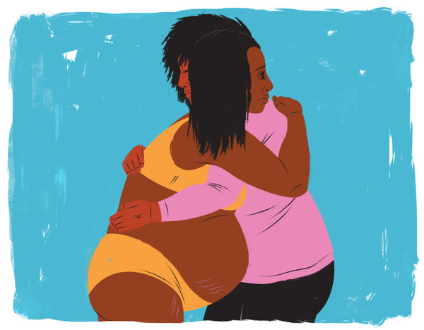 Doula holding mother during early labor
