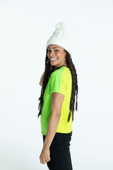 Side view of woman golfer wearing a chartreuse yellow Two a Tee shortsleeve golf shirt