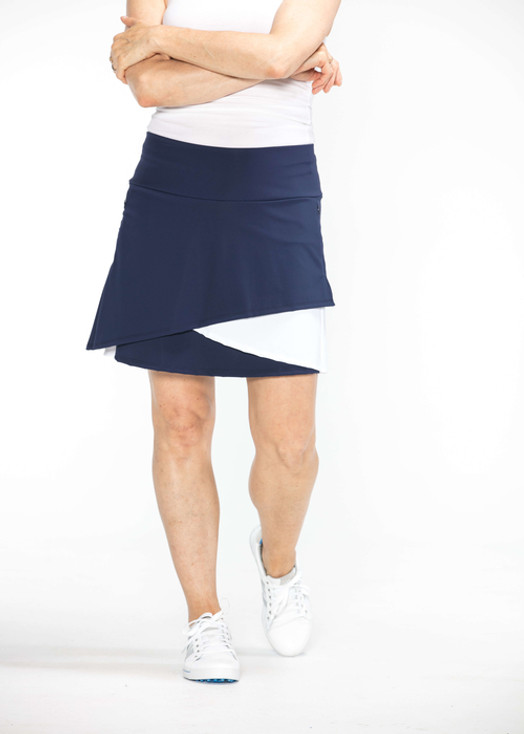 Woman wearing navy blue and white Wrap It Up golf skort