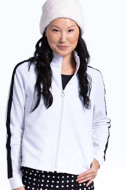 women wearing white zip front lightweight golf jacket