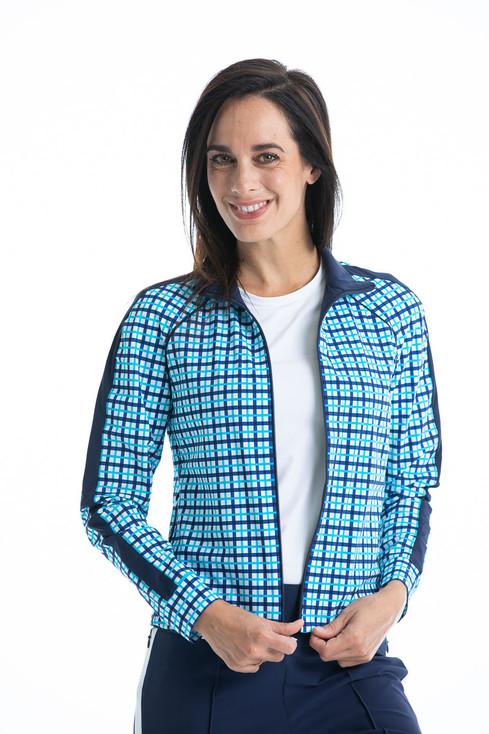women golfer zipping up blue check jacket