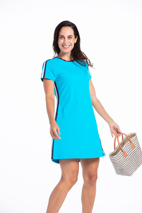 women golfer in a bright blue dress.
