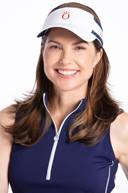 Woman golfer in navy blue Keep it Covered sleeveless golf top and white No Hat Hair visor