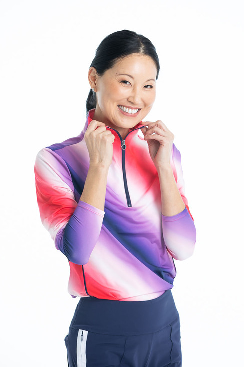Woman smiling wearing a Keep it Covered Longsleeve Golf Top in Ombre Print