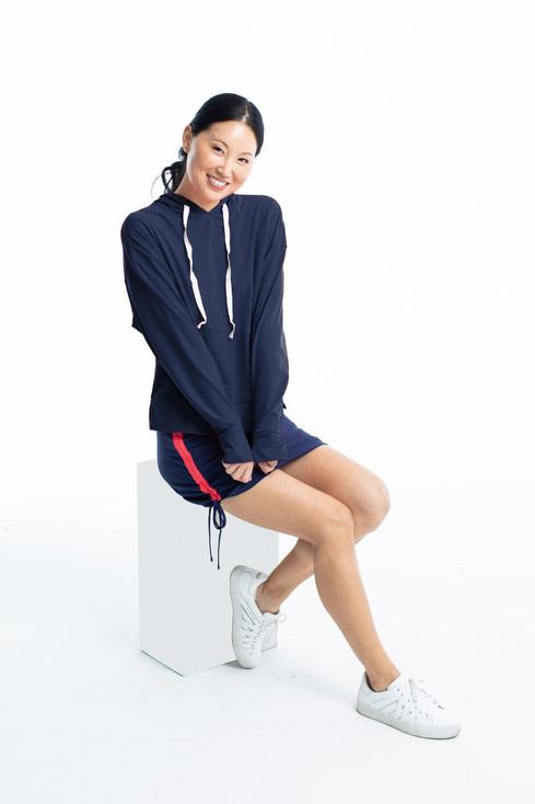 Women golfer in KINONA longsleeve hoodie