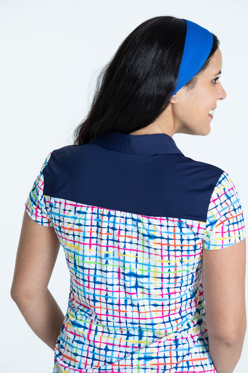 Back view of woman golfer in a blurred lines Shoulder Opener Shortsleeve golf shirt.
