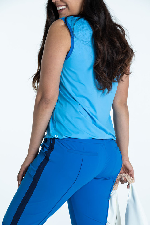 Back view of blueberry blue Tailored Track golf pants with a cornflower blue Free and Easy sleeveless golf top