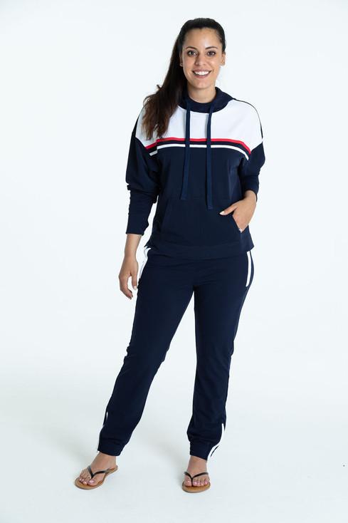 Smiling woman wearing a navy blue Apres 18 Sporty Stripe Longsleeve Hoodie