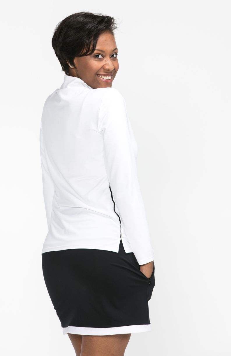 Back view of woman wearing a white longsleeve Keep it Covered golf top