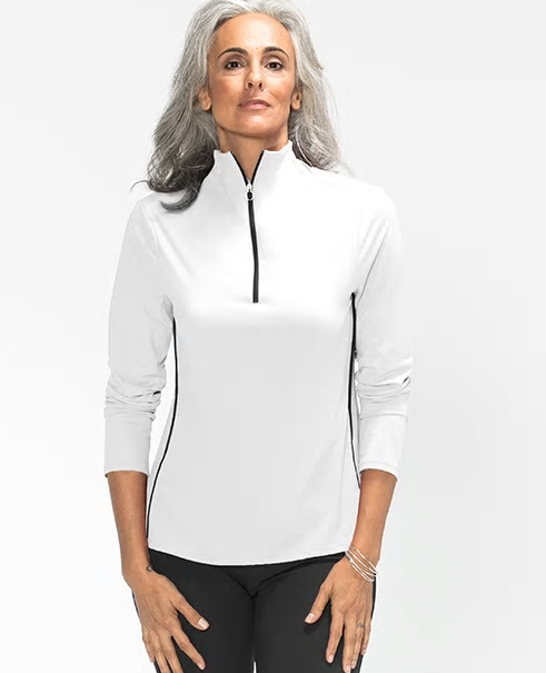 Woman wearing a white longsleeve Keep it Covered golf top