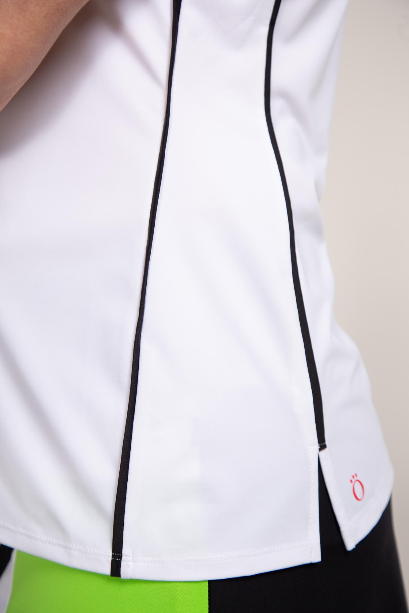 Woman golfer in white Keep it Covered sleeveless golf top