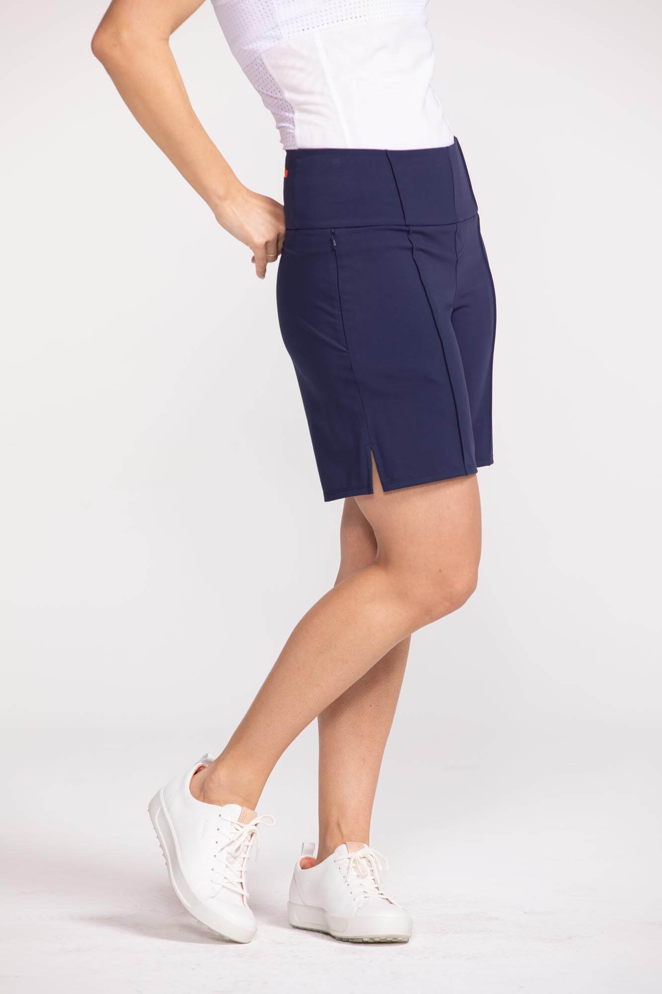 Side view of woman wearing navy blue Tailored and Trim golf short