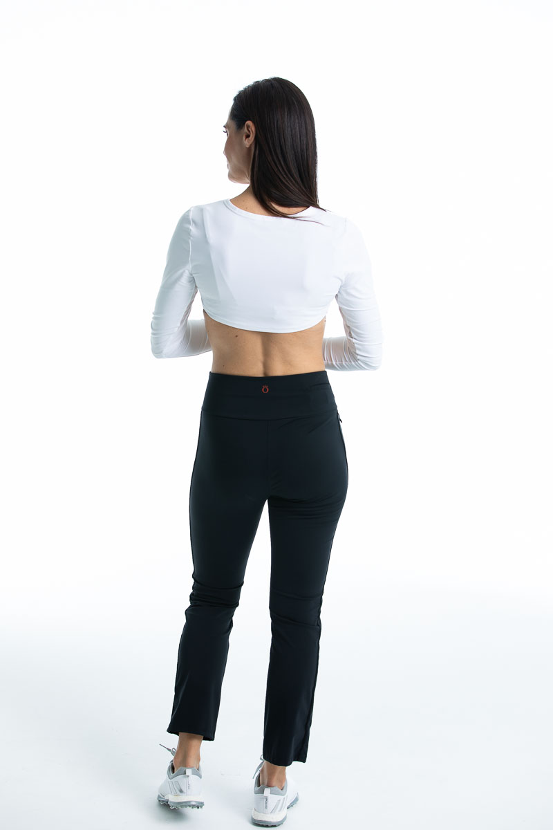 Back view of a woman wearing a white Sun's Out Shrug With Mesh