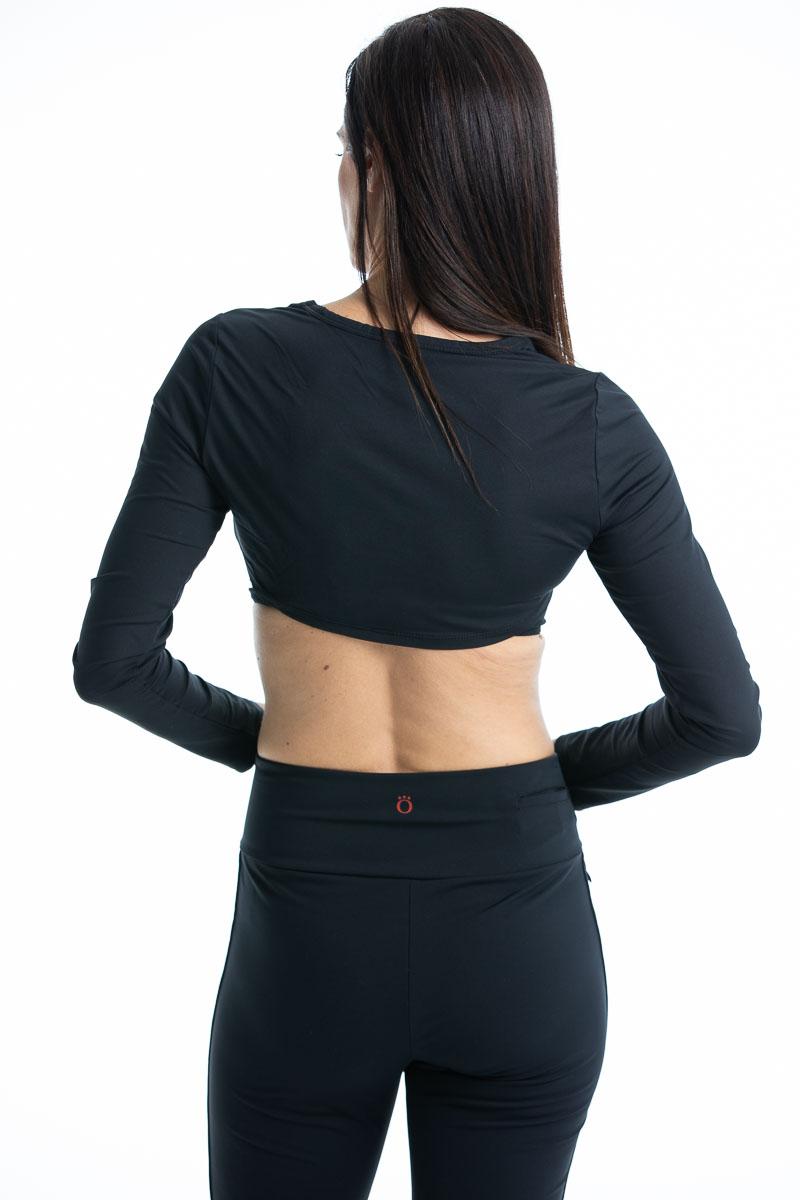 women back view of black golf sun shirt