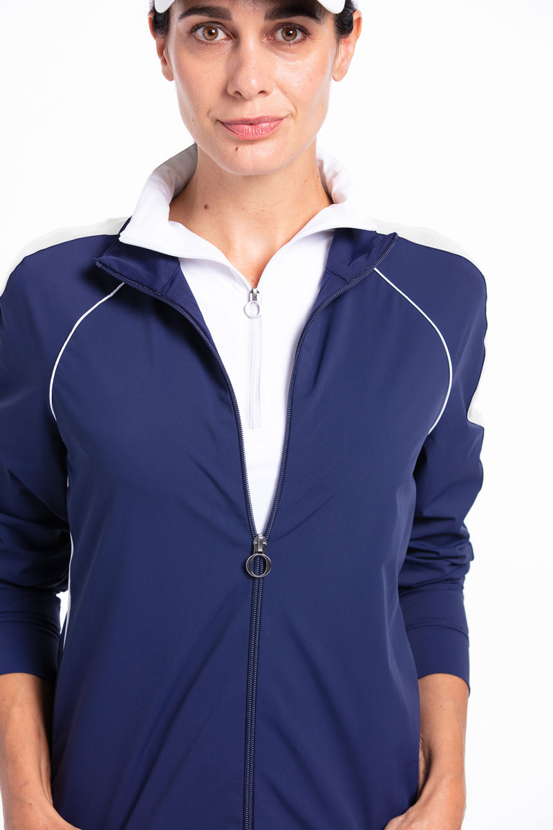 Woman golfer in navy blue Layer Up Jacket