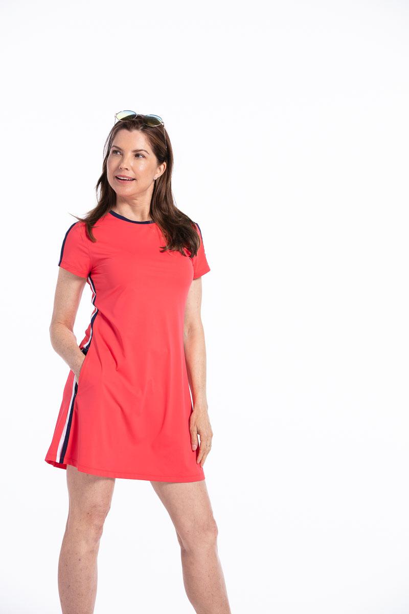 women in a red tee shirt golf dress.