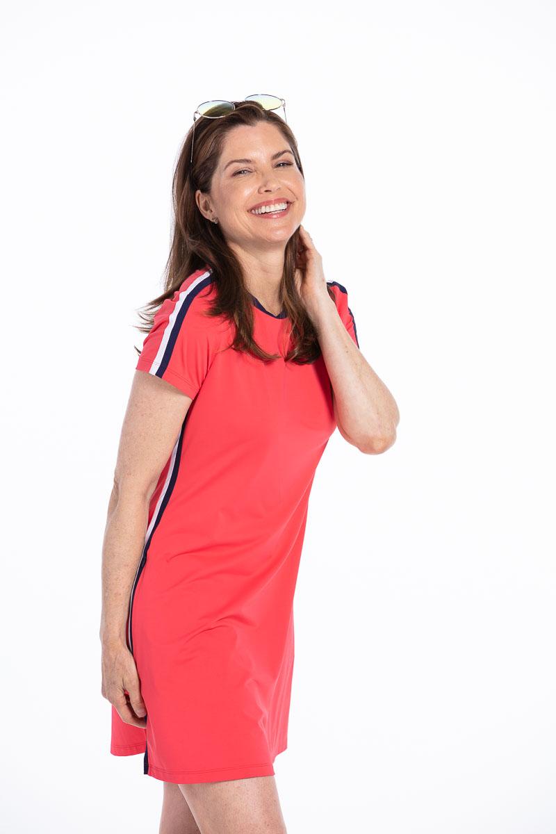 women golfer in a red tee shirt style golf dress.