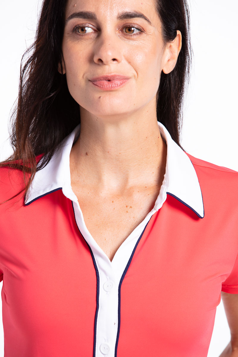 Close up of woman golfer in watermelon red Class Act shortsleeve golf shirt