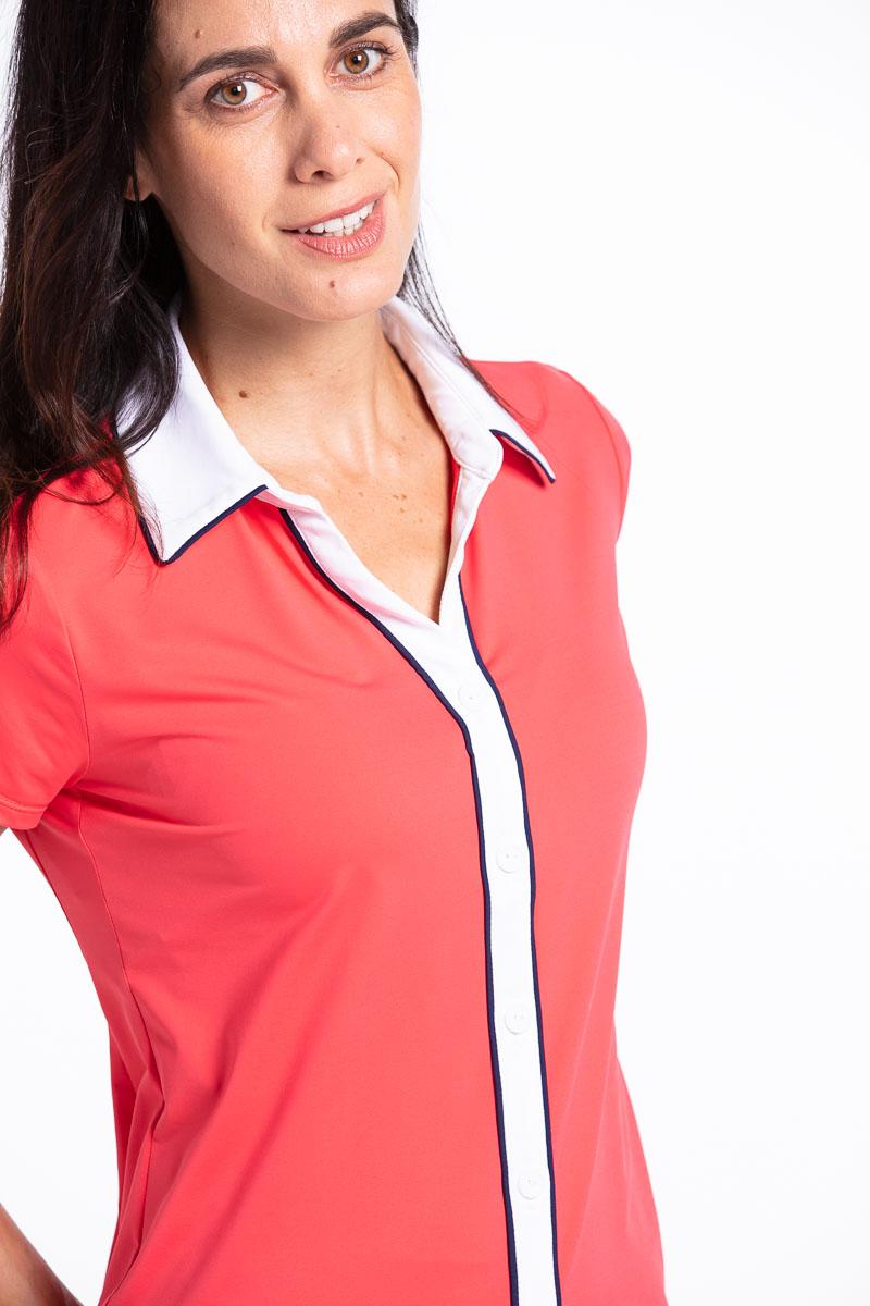 Closer view of woman golfer in watermelon red Class Act shortsleeve golf shirt