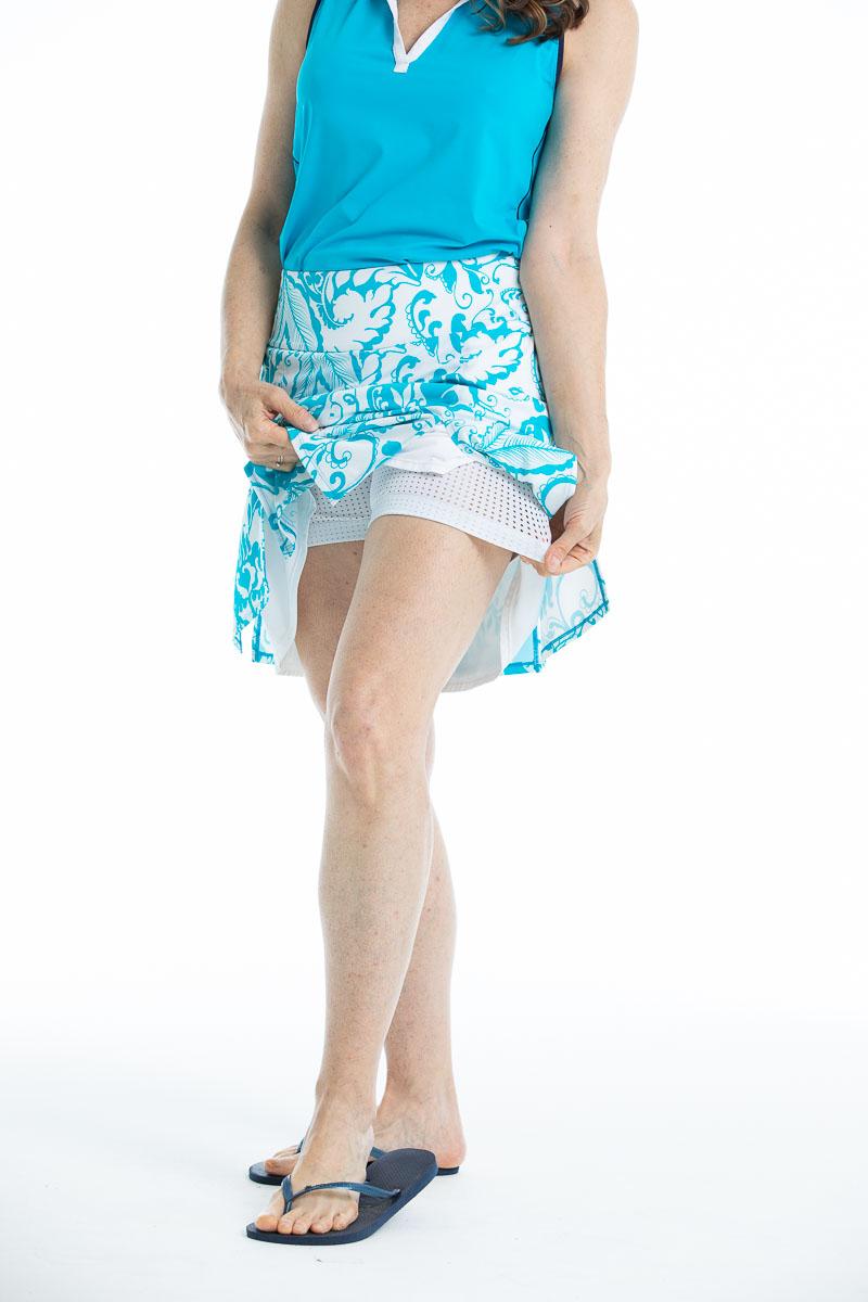 women wearing floral blue golf skort with a built in undershort.