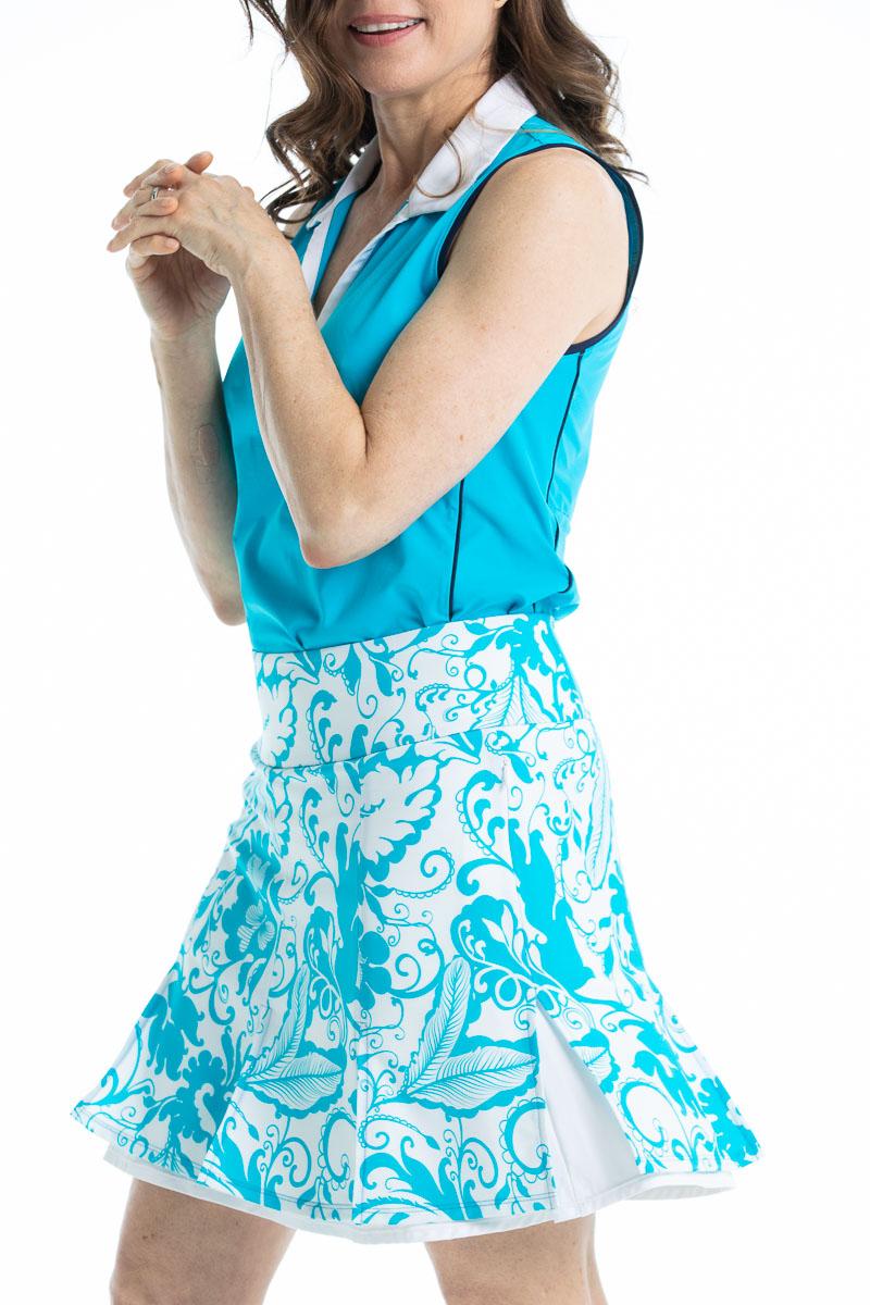 women wearing a blue sleeveless golf short and matching floral print golf skort.