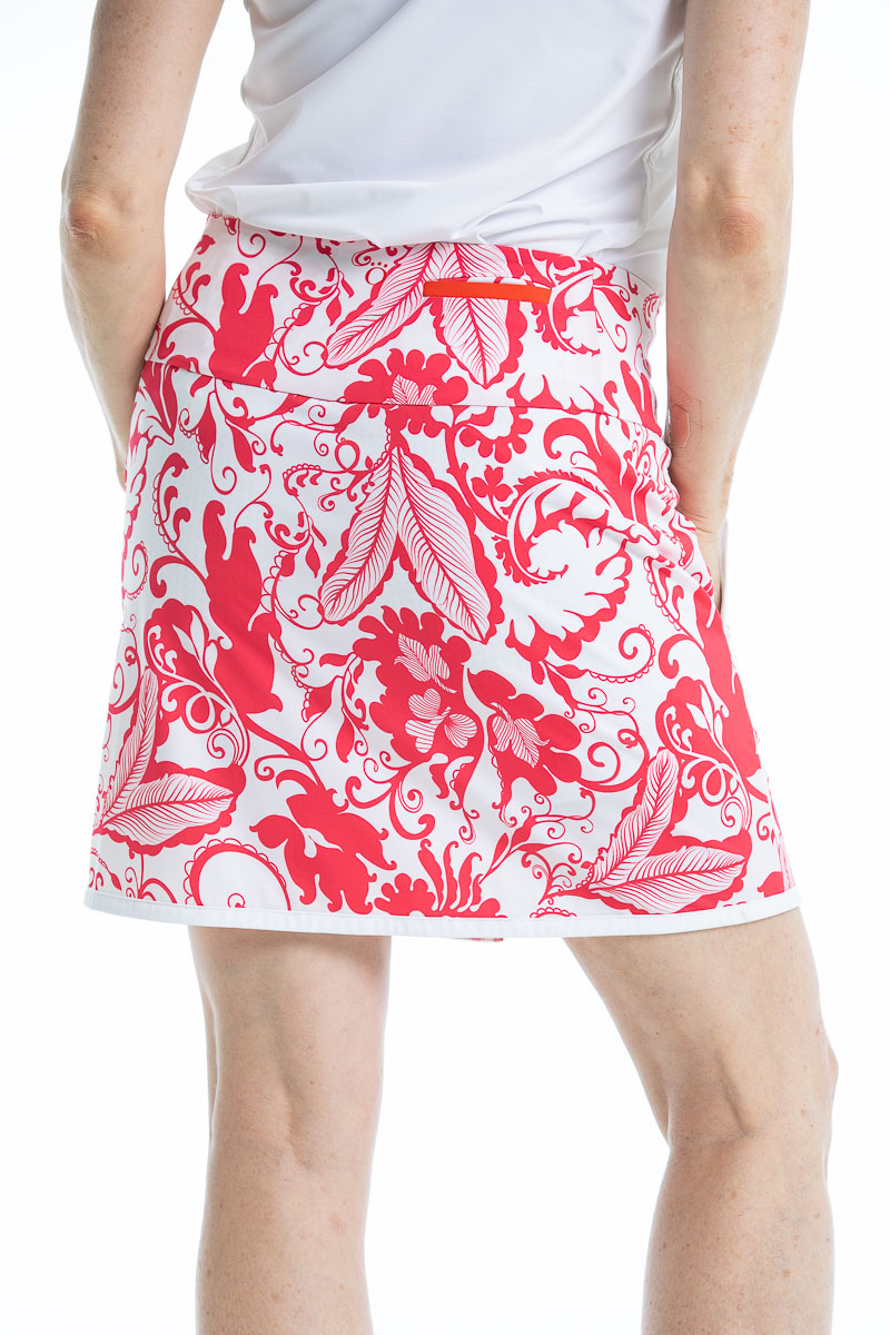 Back view of a women wearing a pink floral golf skort.