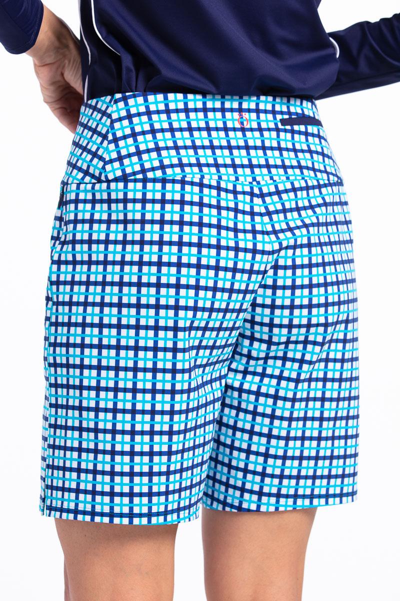women wearing blue check golf short with navy shirt