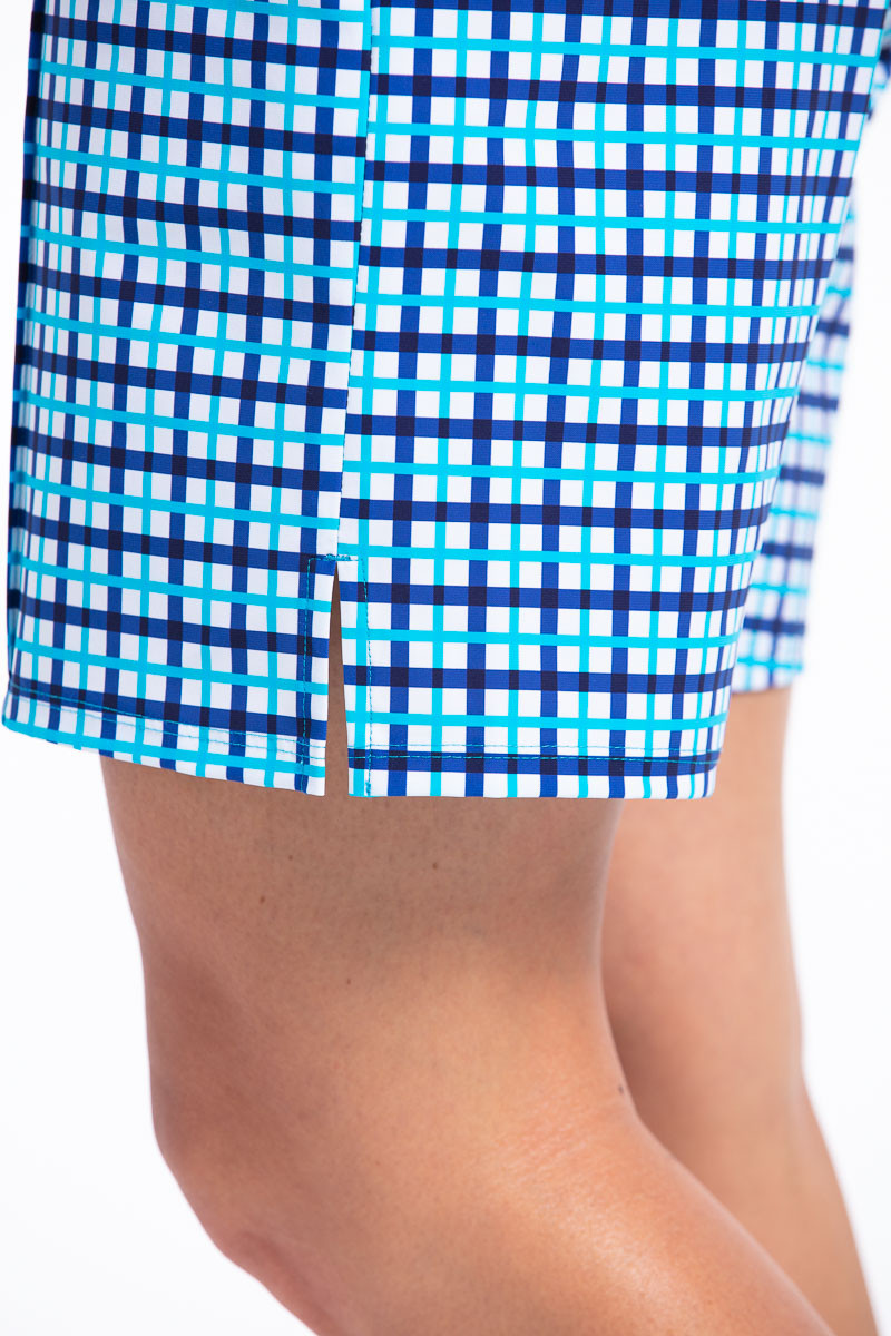 women wearing blue check golf short