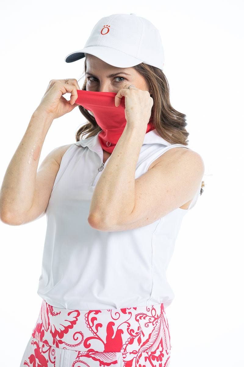 Woman wearing a watermelon red Sun's Out Face and Neck Scarf over her face