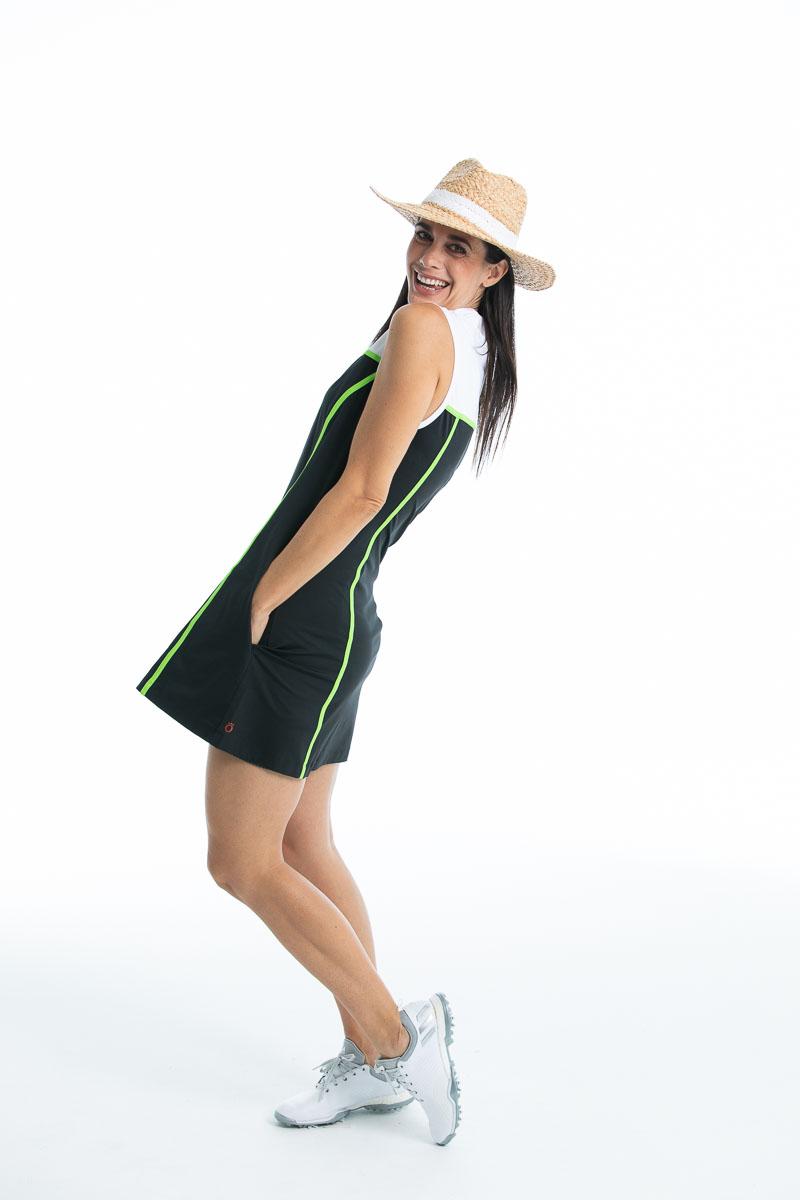 women leaning back wearing black sleeveless golf dress and straw hat