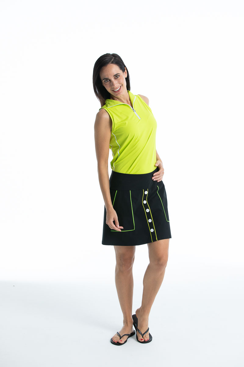 women golfer wearing chartreuse yellow sleeveless top and black golf skort