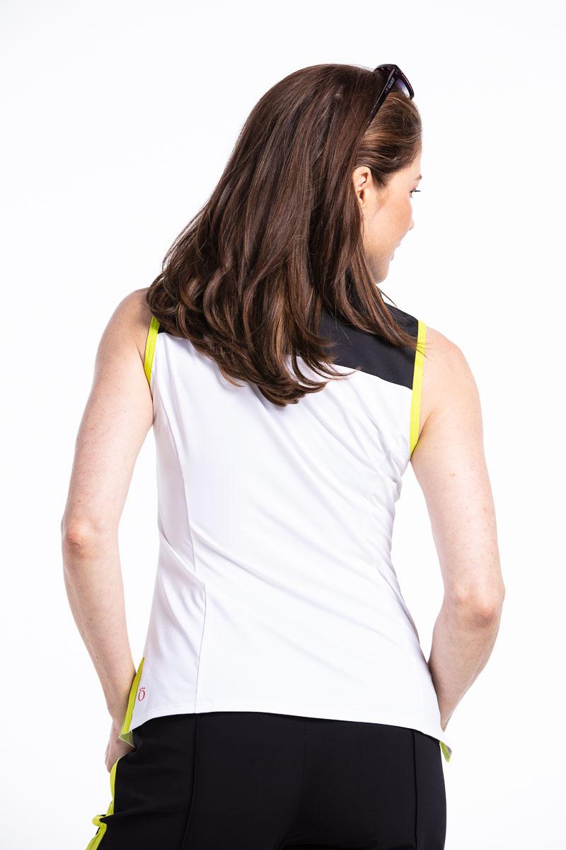 women golfer back view wearing sleeveless white golf top