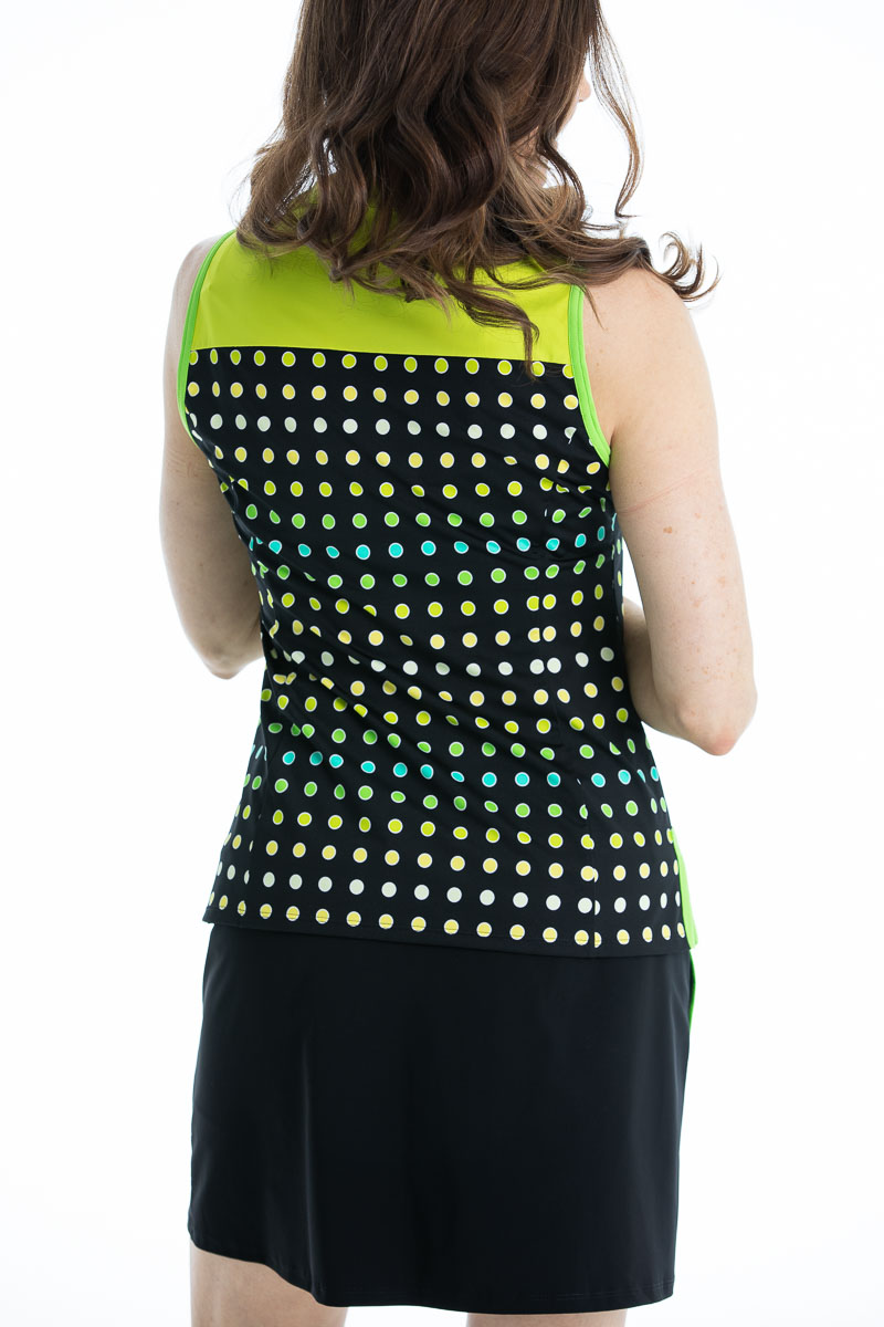 women golfer back view in  black polka dot sleeveless top.