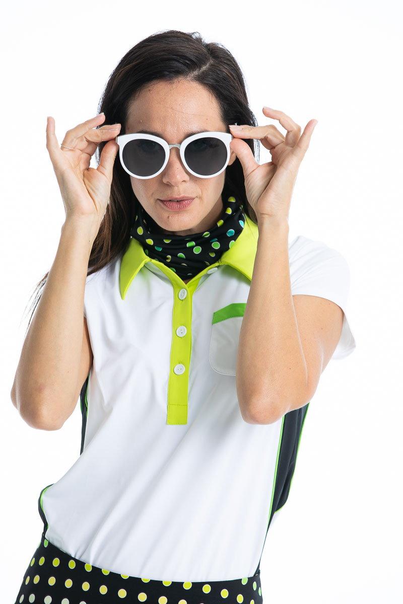 women golfer in sunglasses wearing a white shortsleeve golf shirt