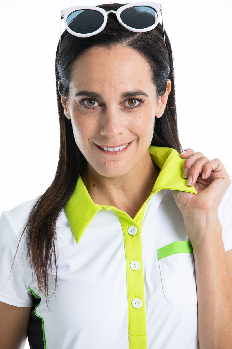 women wearing a white golf polo shirt and holding her collar.