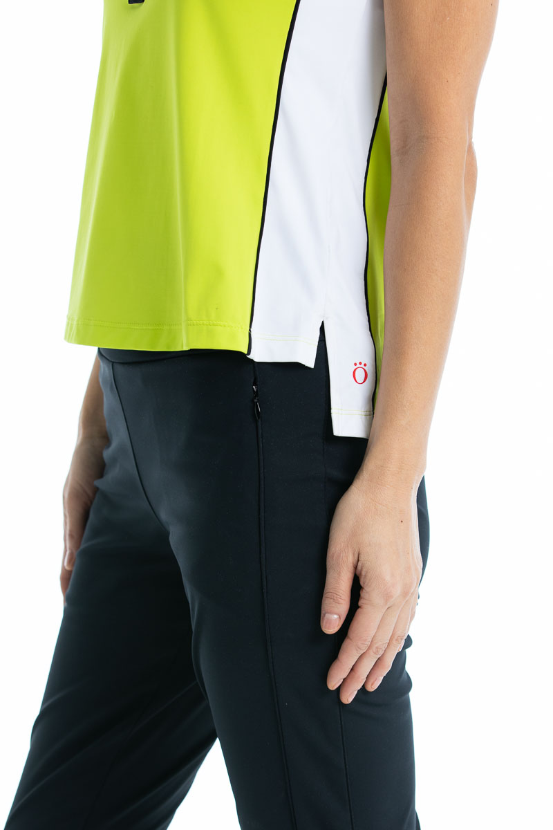 women profile wearing a charetreuse yellow top and black pant
