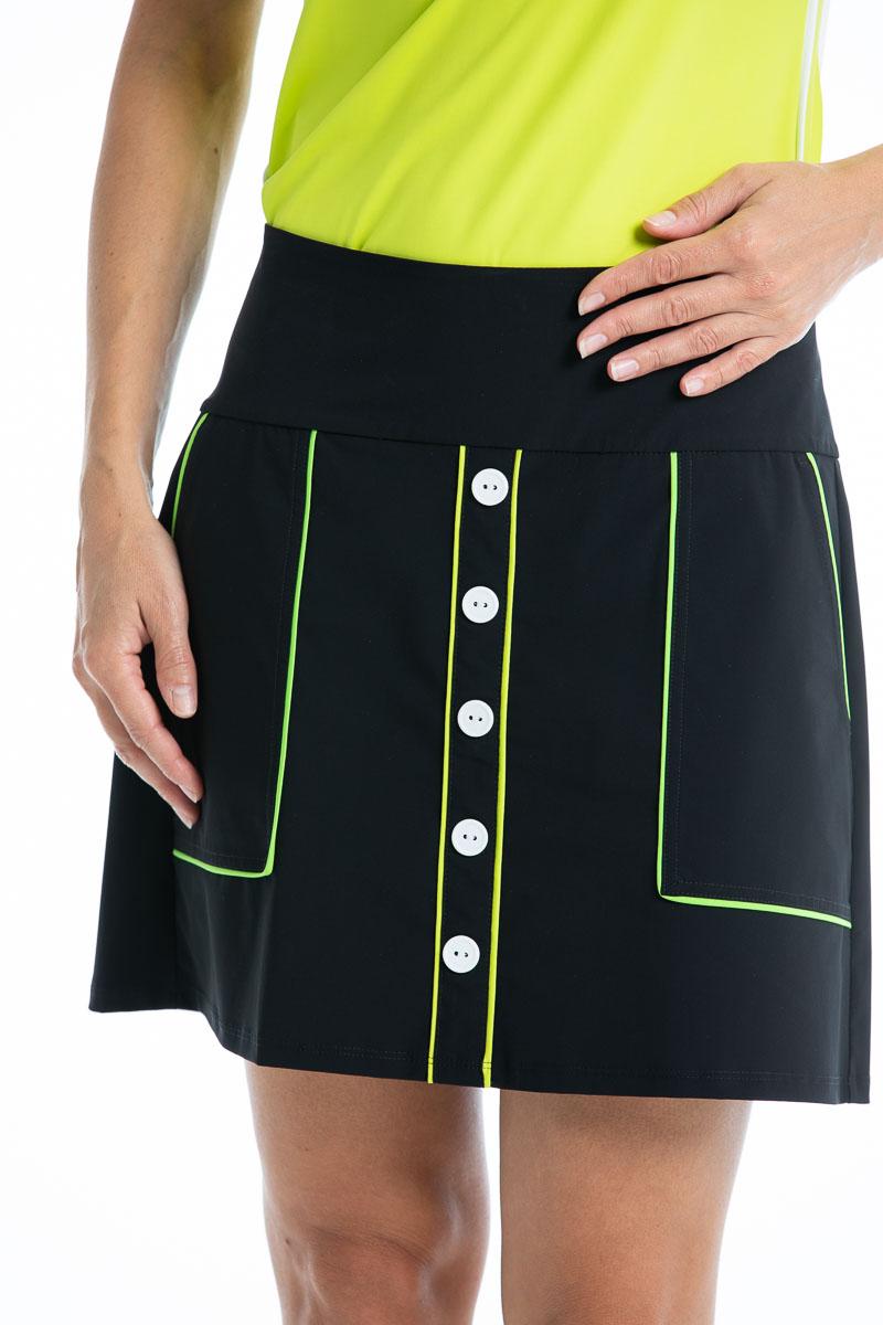 women golfer wearing black golf skort with white buttons